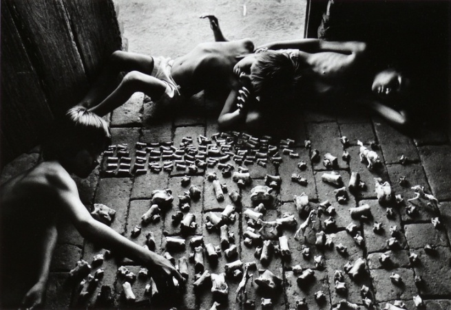 Fig. 1. © Sebastião Salgado (1983) Children playing with animals bones, Brazil